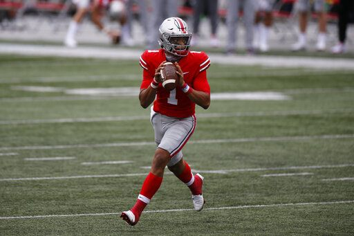 Ohio State quarterback Justin Fields drops back to pass against Nebraska during the second half of an NCAA college football game Saturday, Oct. 24, 2020, in Columbus, Ohio. Ohio State defeated Nebraska 52-17.