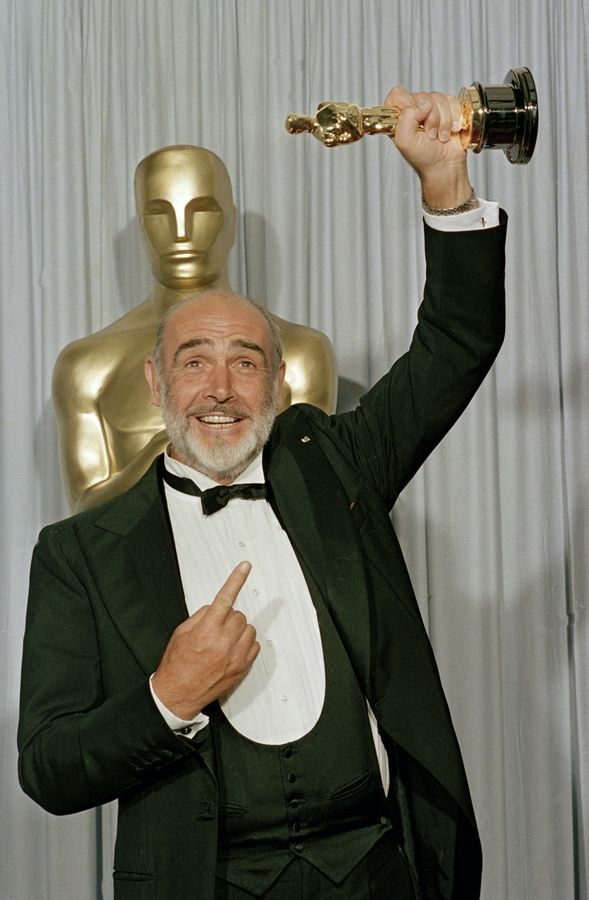 "FILE -- In this file photo dated April 11, 1988, Sean Connery holds up his best supporting actor Oscar for ""The Untouchables"" at the 60th annual Academy Awards in Los Angeles, Ca., USA. Scottish actor Sean Connery, considered by many to have been the best James Bond, has died aged 90, according to an announcement from his family."
