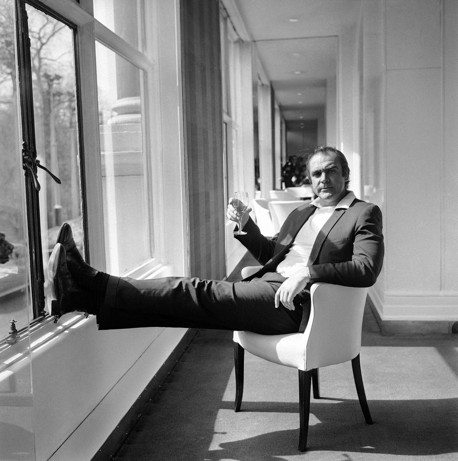 "FILE -- In this file photo dated April 11, 1971, renowned British actor Sean Connery, famous for his role as secret agent James Bond 007, relaxes at the River Room of the Savoy Hotel in London, after coming back from ""The Grave"" to take his famous Bond role in the United Artists film version of the James Bond story ""Diamonds Are Forever."" Connery, 40, later left for Las Vegas where filming for the picture is in progress. Scottish actor Sean Connery, considered by many to have been the best James Bond, has died aged 90, according to an announcement from his family."