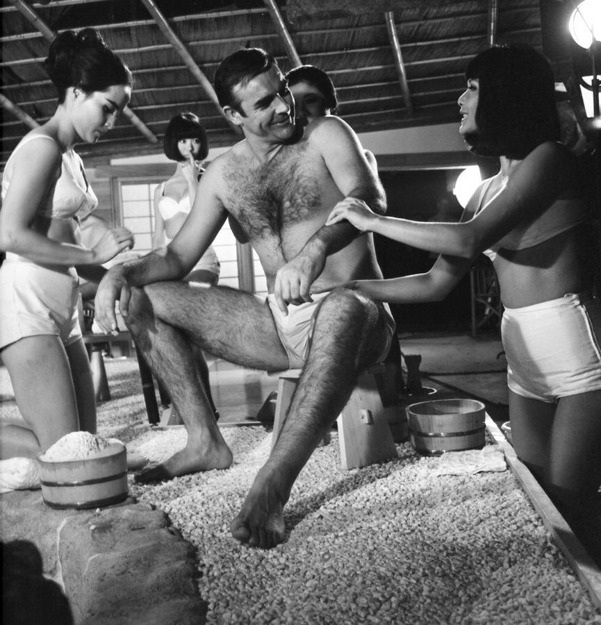 FILE -- In this file photo dated Sept. 26, 1966, British actor Sean Connery, being given a Japanese bath, during filming of a scene in the James Bond film, You Only Live Twice, at Pinewood Studios near London. The actresses shown are Yasuko Nagazuni, at left and Yee Wah Yang at right. Scottish actor Sean Connery, considered by many to have been the best James Bond, has died aged 90, according to an announcement from his family.