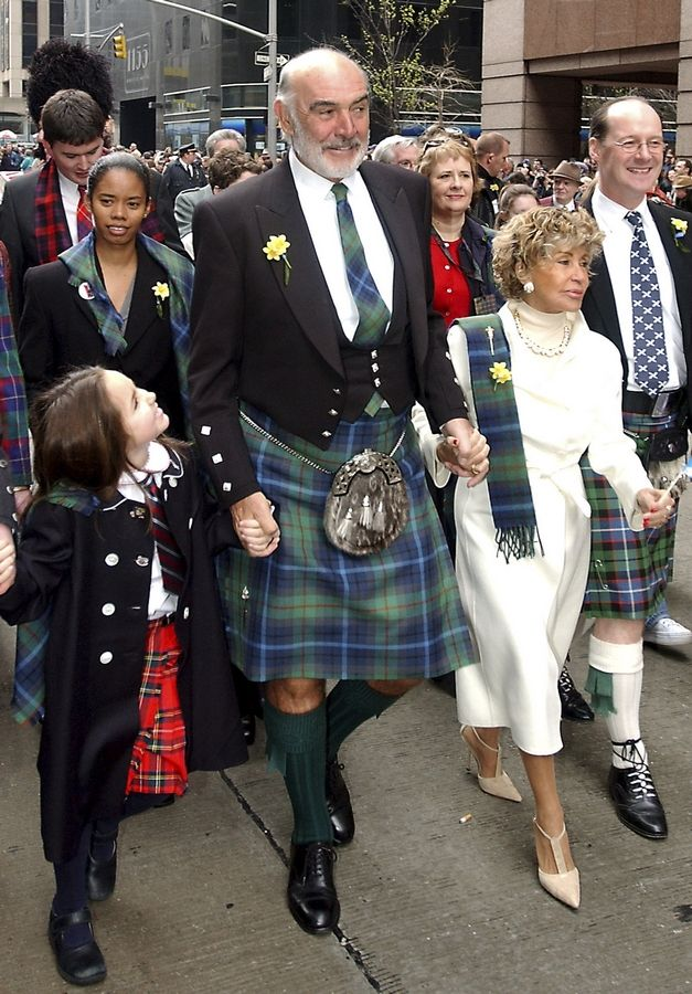 FILE -- In this file photo dated Saturday, April 6, 2002, Scottish actor Sean Connery, center, leads a procession up New York's Sixth Avenue as part of a bagpipe band of about 10,000, billed as the world's largest pipe and drum parade. The parade was to benefit cancer victims through the Marie Curie Cancer Care organization, and the New York-based Gilda's Club Worldwide, a support network named after the late actress Gilda Radner. Scottish actor Sean Connery, considered by many to have been the best James Bond, has died aged 90, according to an announcement from his family.