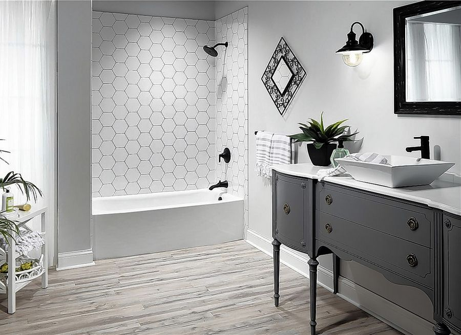 Bath Planet recommends the Hero Othello hexagon pattern with laser-engraved dark grout lines, with a low-threshold walk-in shower base (not pictured).
