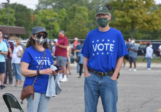Early voting and voting by mail have proved to be exceptionally popular options this year because of the COVID-19 crisis. Lines of masked voters like these have been long.