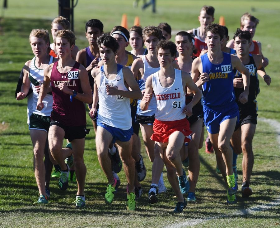 Runners are grouped close together early in the Class 3A Hoffman Estates cross country sectional Saturday.