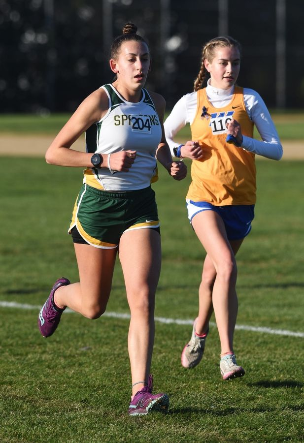 Glenbrook North's Natalie Sandlow, left, and Warren's Mia Pasha run during the Class 3A Hoffman Estates cross country sectional.