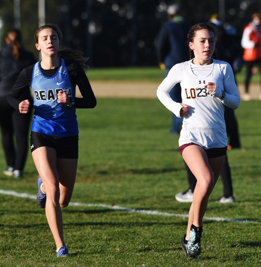 Lake Zurich's Brooke Johnson, left, and Loyola's Morgan Mackie run alongside one another during the Class 3A Hoffman Estates cross country sectional Saturday.