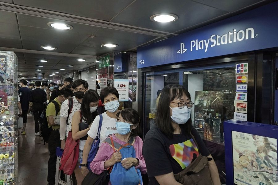 Gaming enthusiasts queue up in September for preorder sales of Sony's PlayStation 5 outside a retailer in Hong Kong.