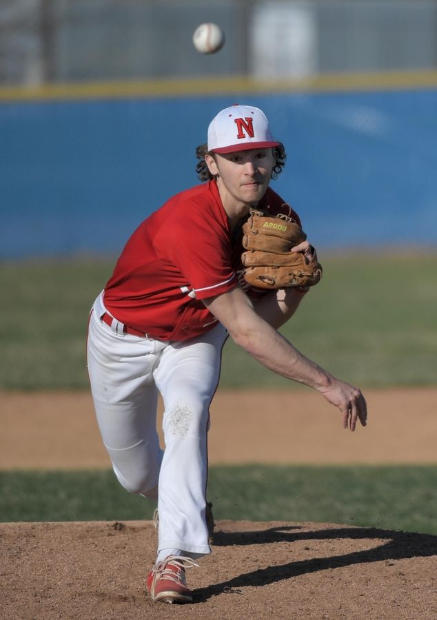 Naperville Central's Jared Suchevits pitches against Neuqua Valley in a baseball game in Naperville in 2019. The IHSA's waiver allowing spring and summer athletes to participate on both their club and high school teams has been met with some concern, especially over pitch counts in baseball.