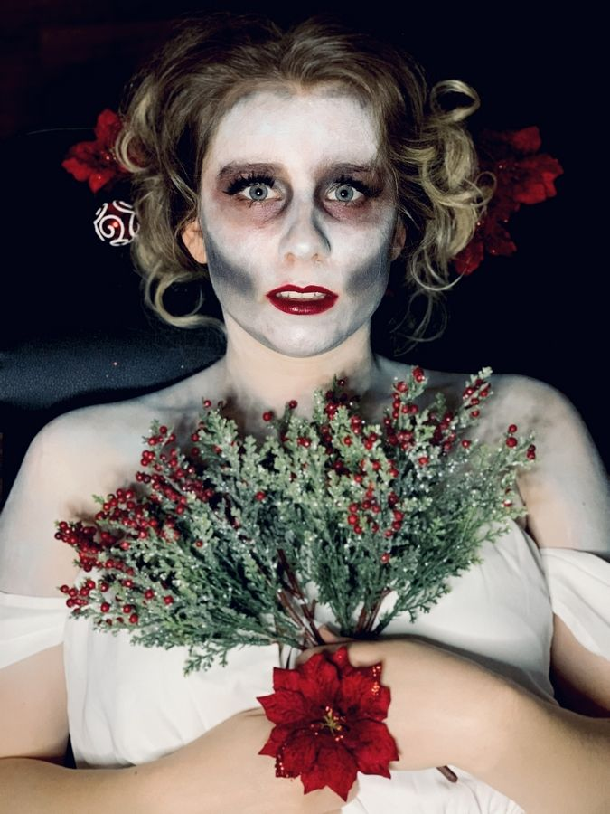 "Brina Kay poses in zombie makeup with Christmas decor for photo used to promote her new song ""Ghost of Christmas Past"" on instagram Marion Shaina"