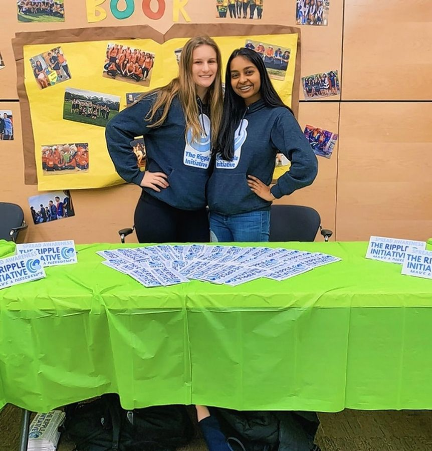 Caroline Mazur-Sarocka, left, and Rishika Chikoti, right, distributed more than 200 informational pamphlets at the Stevenson High School Mental Health Forum.
