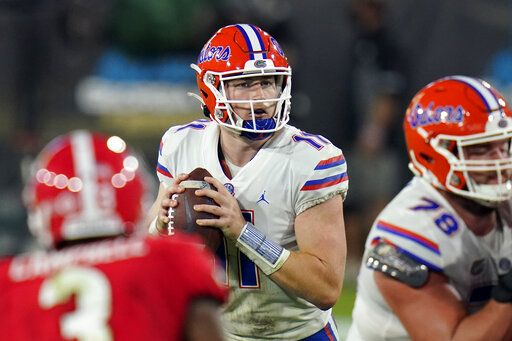 Florida quarterback Kyle Trask (11) looks for a receiver during the second half of the team's NCAA college football game against Georgia, Saturday, Nov. 7, 2020, in Jacksonville, Fla.