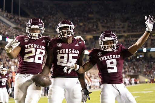 Texas A&M tight end Jalen Wydermyer (85) celebrates with Isaiah Spiller (28) and Hezekiah Jones (9) after a touchdown catch against Arkansas during the second half of an NCAA college football game Saturday, Oct. 31, 2020, in College Station, Texas.