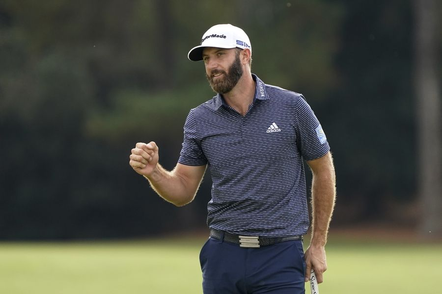 Dustin Johnson pumps his fist after wining the the Masters golf tournament Sunday, Nov. 15, 2020, in Augusta, Ga.