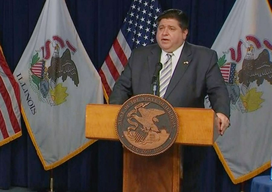 "Gov. J.B. Prtizker gives a COVID-19 update on Nov. 9. He said Monday that the state is looking at ""painful"" budget cuts."