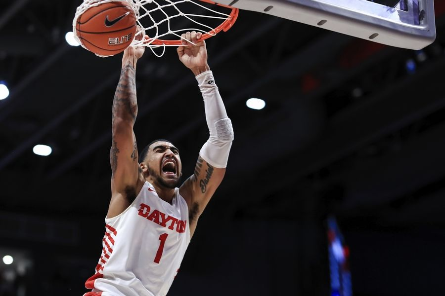 FILE -- In this Feb. 22, 2020, file photo, Dayton's Obi Toppin dunks during the second half of the team's NCAA college basketball game against Duquesne in Dayton, Ohio. Toppin is a potential lottery pick in next week's NBA draft after being named The Associated Press men's college basketball player of the year last season.
