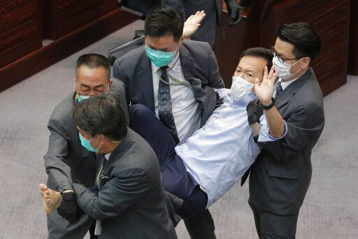 Former Hong Kong lawmakers who disrupted session arrested