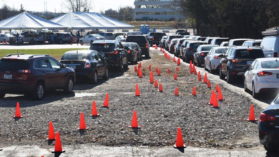 Drivers split off into three lanes as they wait for a COVID-19 test Tuesday at the Illinois Department of Public Health testing site on Farnsworth Road in Aurora. Though the wait time was around an hour Tuesday, officials have seen up to three hours' wait.