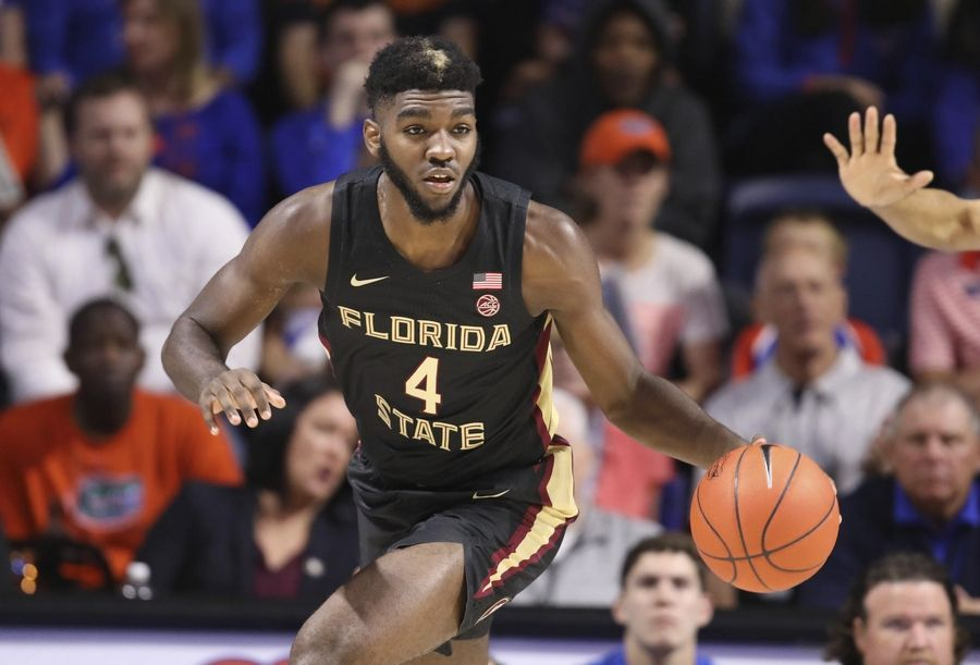 In this Nov. 10, 2019, file photo, Florida State forward Patrick Williams (4) dribbles up court against Florida during the first half of an NCAA college basketball game in Gainesville, Fla.