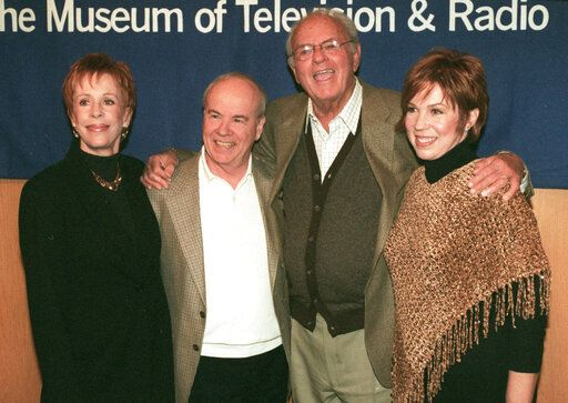 "REMOVES REFERENCE TO HULU - FILE - Cast members of ""The Carol Burnett Show"", from left, Carol Burnett, Tim Conway, Harvey Korman and Vicki Lawrence pose for a photo before attending a discussion of the former television show at the Director's Guild Theater in the Hollywood section of Los Angeles, on March 3, 2000.  Episodes of ""The Carol Burnett Show"" are available on streaming services like Tubi and The Roku Channel."