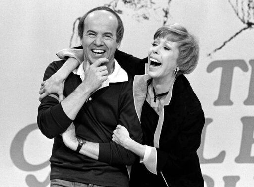"REMOVES REFERENCE TO HULU - FILE - Carol Burnett, right, shares a laugh with Tim Conway during a taping of her final show on March 19, 1978, in Los Angeles. Episodes of ""The Carol Burnett Show"" are available on streaming services like Tubi and The Roku Channel."