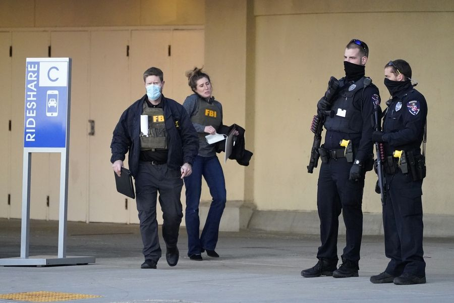 Police and FBI agents investigate a shooting at the Mayfair Mall, Friday, Nov. 20, 2020, in Wauwatosa, Wis. Multiple people were shot Friday afternoon at the mall, and police are still searching for the shooter.