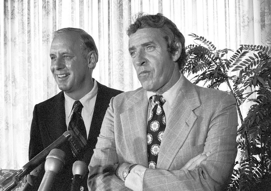 Jim Finks, right, listens to a question at a news conference Sept. 12, 1974 after he was named the Bears' general manager, replacing George Halas Jr.