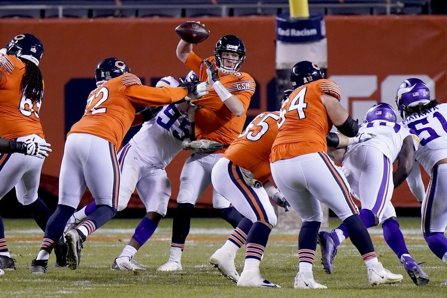 Chicago Bears quarterback Nick Foles is hit by Minnesota Vikings defensive end Ifeadi Odenigbo (95) during the second half of an NFL football game Monday, Nov. 16, 2020, in Chicago. Foles was injured on the play and left the game on a cart.