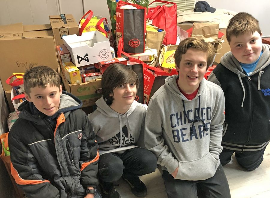 Jack Aliprandi, second from right, and classmates from St. Raymond's School helped collect donations during last year's food drive.