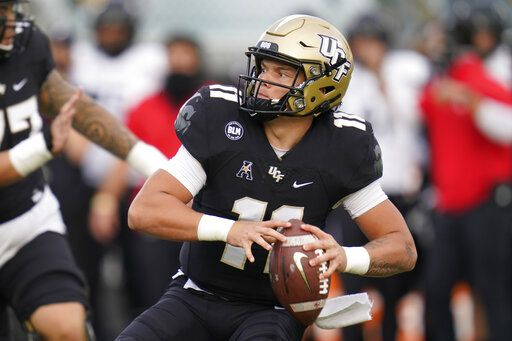 Central Florida quarterback Dillon Gabriel looks for a receiver during the first half of an NCAA college football game against Cincinnati, Saturday, Nov. 21, 2020, in Orlando, Fla.