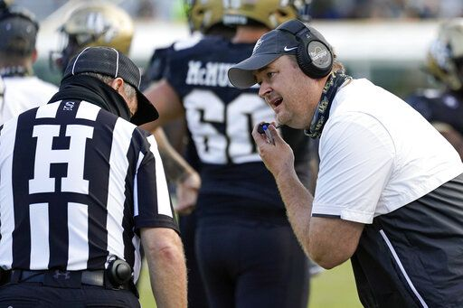 Central Florida head coach Josh Heupel, right, has words with head linesman Jim Casey, left, during the first half of an NCAA college football game against Cincinnati, Saturday, Nov. 21, 2020, in Orlando, Fla.