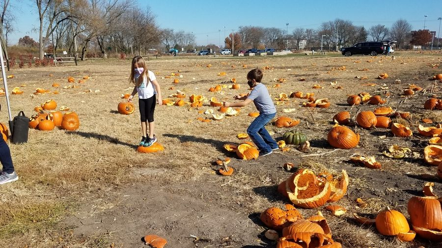 Mia, left, and Alexi Maglaris enjoy smashing pumpkins at the Naperville Park District's fourth annual Pumpkin Smash at the Ron Ory Community Garden Plots on Sat., Nov. 7.