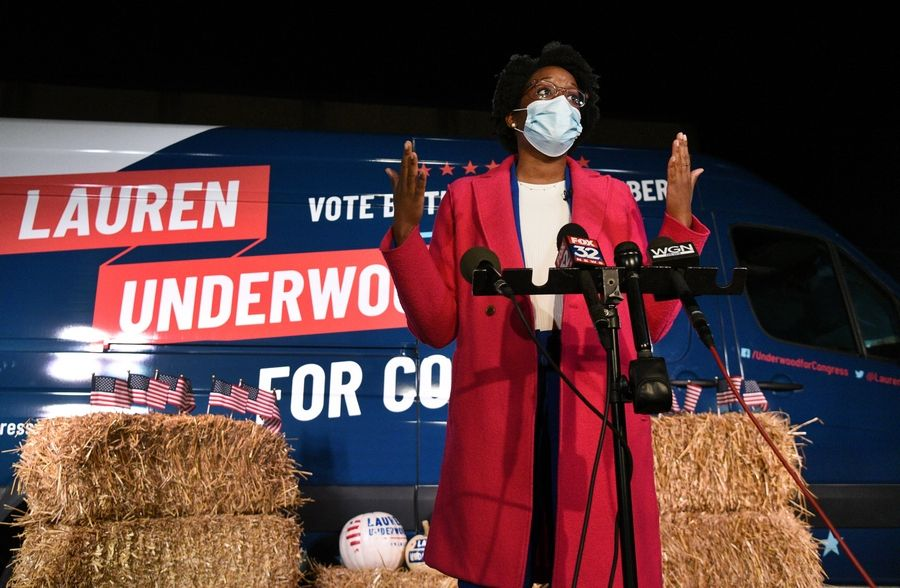 U.S. Rep. Lauren Underwood talks to the media on election night. She won reelection with the support of people who voted early by mail, unofficial results showed.