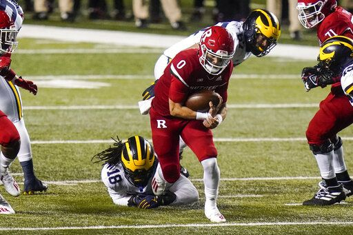 Rutgers' Noah Vedral (0) rushes past Michigan's Luiji Vilain (18) during the first half of an NCAA college football game Saturday, Nov. 21, 2020, in Piscataway, N.J.