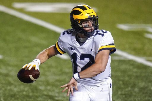Michigan's Cade McNamara throws a pass during the second half of an NCAA college football game against Rutgers on Saturday, Nov. 21, 2020, in Piscataway, N.J. Michigan won 48-42.