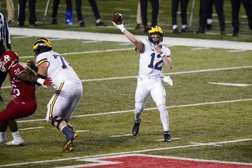 Michigan's Cade McNamara throws a pass during the second half of the team's NCAA college football game against Rutgers on Saturday, Nov. 21, 2020, in Piscataway, N.J. Michigan won 48-42.