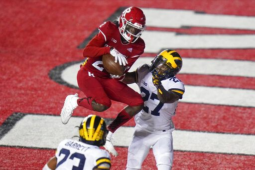 Rutgers' Aron Cruickshank (2) catches a pass for a touchdown in front of Michigan's Hunter Reynolds (27) during the second half of an NCAA college football game Saturday, Nov. 21, 2020, in Piscataway, N.J. Michigan won 48-42.