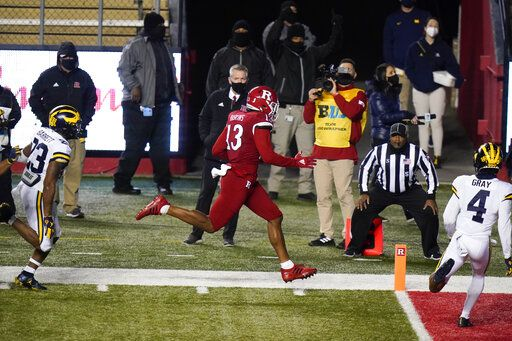 Rutgers' Jovani Haskins (13) scores a touchdown during the second overtime of an NCAA college football game Saturday, Nov. 21, 2020, in Piscataway, N.J. Michigan won 48-42.