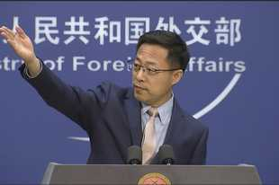 "Chinese foreign ministry spokesperson Zhao Lijian gestures Monday during a press briefing in Beijing. China on Monday lashed out at Washington over its withdrawal from the ""Open Skies Treaty"" with Russia, saying the move undermined military trust and transparency and imperiled future attempts at arms control."