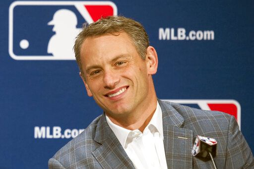 FILE - In this Dec. 7, 2016, file photo, Chicago Cubs general manager Jed Hoyer smiles during a press conference in Oxon Hill, Md. Theo Epstein, who transformed the long-suffering Chicago Cubs and helped bring home a drought-busting championship in 2016, is stepping down after nine seasons as the club's president of baseball operations. The team announced Monday, Nov. 16, 2020, Epstein is leaving the organization, and general manager Jed Hoyer is being promoted to take his place.