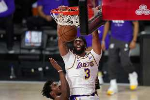 Anthony Davis dunks against Miami's during the NBA Finals last month. Could Davis, who will play for the Lakers again this year, be on the Bulls' radar for next season?
