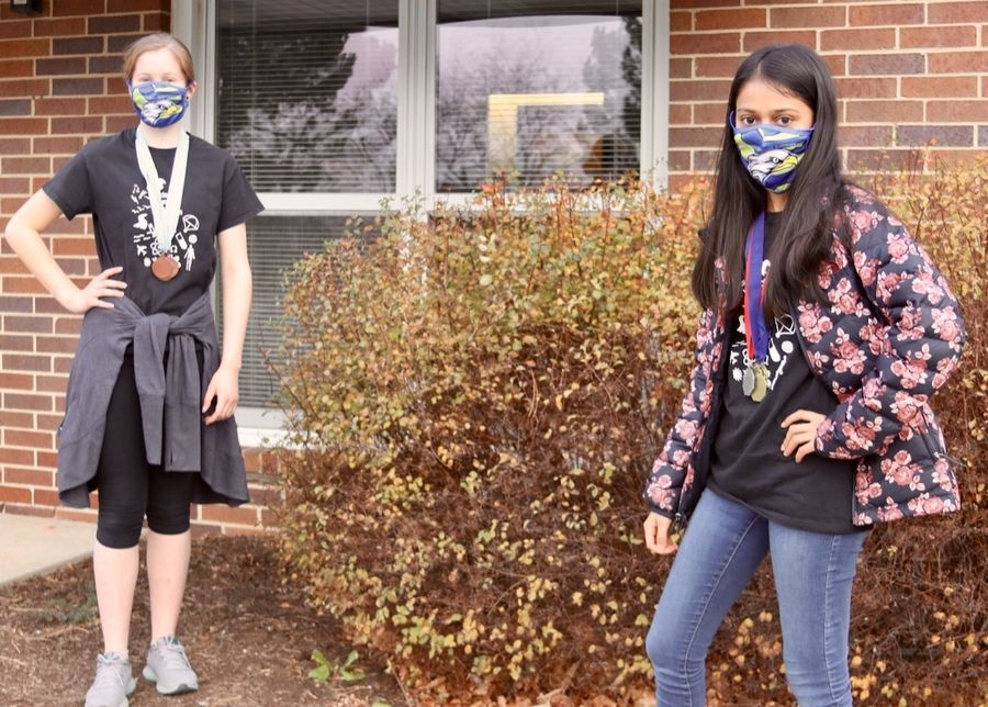 (Left to right) Madelyn Wright and Zoe Mehta, eighth-grade students at Hawthorn Middle School North in Vernon Hills, recently received medals in Experimental Design at two national Science Olympiad virtual tournaments. This photo was taken at Hawthorn's District Office in Vernon Hills on 11/23/2020.