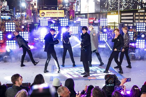 "FILE - Members of BTS perform at the Times Square New Year's Eve celebration in New York on Dec. 31, 2019. The K-pop band is nominated for a Grammy Award for best pop duo/group performance with 'œDynamite,"" their first song to hit the No. 1 spot on the Billboard Hot 100 chart. (Photo by Ben Hider/Invision/AP, File)"