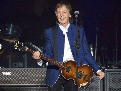"FILE - In this Monday, July 10, 2017 file photo, Paul McCartney performs at Amalie Arena in Tampa, Fla. McCartney scored his 79th Grammy nominations this year - as an art director. The former Beatle is nominated for best boxed or special limited edition package for the collector's edition of his 10th solo album, 'œFlaming Pie."" He's listed as one of the art directors on the project, and shares his nomination with Linn Wie Andersen, Simon Earith and James Musgrave."