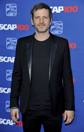 FILE - In this April 23, 2014 file photo, Lukasz Gottwald aka Dr. Luke arrives at the 31st Annual ASCAP Pop Music Awards at the Loews Hollywood Hotel in Los Angeles. Luke, born Lukasz Gottwald, marked a major comeback this year, producing hits for Saweetie, Juice WRLD and Doja Cat, who is signed to his record label. And it earned him his first Grammy nomination in six years. (Photo by Richard Shotwell/Invision/AP, File)