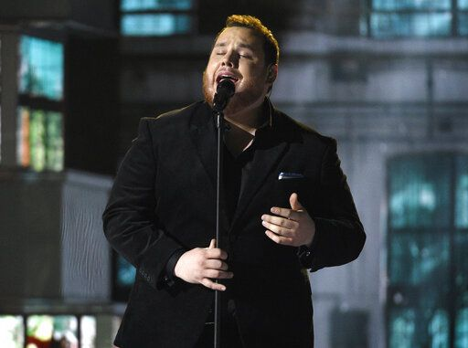 FILE - Luke Combs performs at the 54th annual Academy of Country Music Awards in Las Vegas on April 7, 2019. Combs, who dominated the country charts and was streamed heavily on streaming services, was surprisingly shut out of the Grammy Award nominations this year.(Photo by Chris Pizzello/Invision/AP, File)
