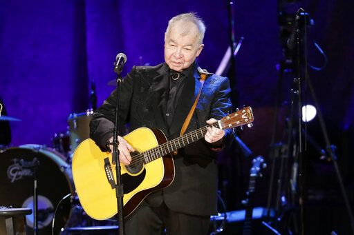 "FILE - In this Sept. 11, 2019, file photo, John Prine performs at the Americana Honors & Awards show in Nashville, Tenn. The icon earned two posthumous Grammy nominations, including best American Roots performance and best American Roots song for 'œI Remember Everything."" Prine died  April 7, 2020, from complications of the coronavirus. He was 73."