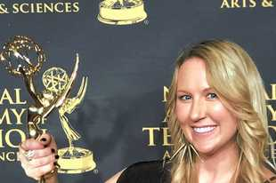 Mount Prospect native and Prospect High School graduate Jackie Decker with one of the four Emmy Awards she's won for her work as a TV sports producer.