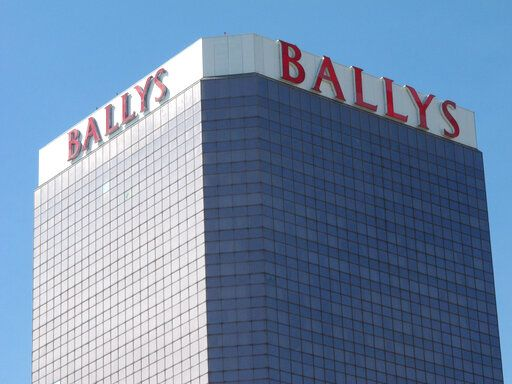 "This Oct. 1, 2020, photo shows the exterior of Bally's casino in Atlantic City, N.J. On Nov. 4, 2020, officials with Twin River Worldwide Holdings, a Rhode Island firm that's buying Bally's for $25 million, said they can make it ""a place to see and be seen"" by investing $90 million into the aging casino and boosting its offerings."
