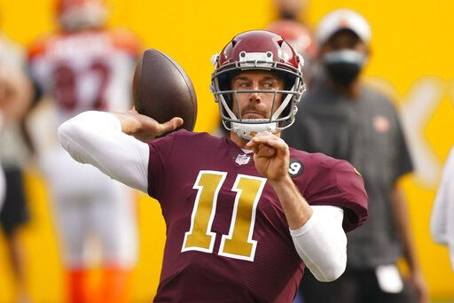 Washington Football Team quarterback Alex Smith (11) throws the ball before the start of an NFL football game against the Cincinnati Bengals, Sunday, Nov. 22, 2020, in Landover, Md.