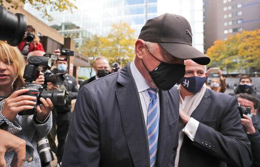Boris Becker leaves Southwark Crown Court in London, Thursday, Oct. 22, 2020. German tennis star Boris Becker is charged with 19 offences of failing to disclose money and property as part of bankruptcy proceedings.